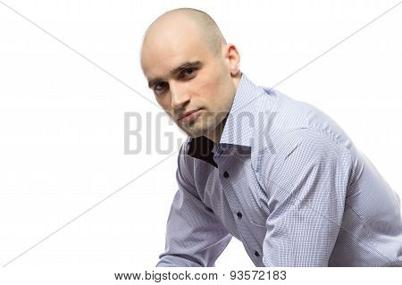 Photo of sitting serious hairless business man