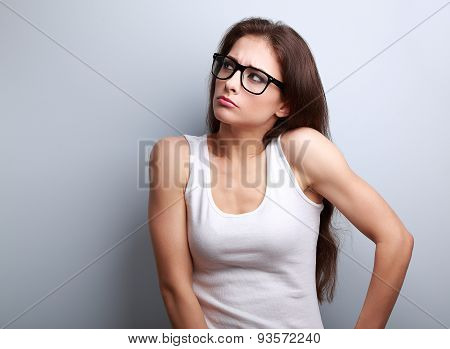 Anger Young Casual Woman In Glasses Thinking And Looking Up