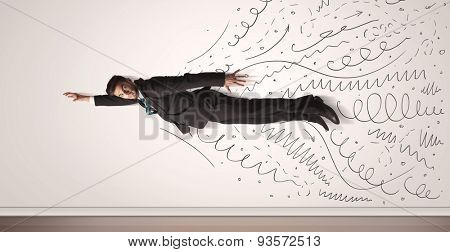 Business man flying with hand drawn lines comming out concept