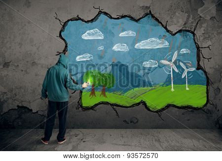 Young urban painter drawing colorful future image on the wall