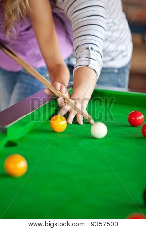 Attentive Boyfriend Learning His Girlfriend How To Play Pool