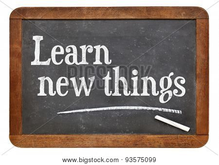 Learn new things - motivational text on an isolated  vintage slate blackboard
