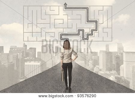 Business woman looking at road with maze and solution concept
