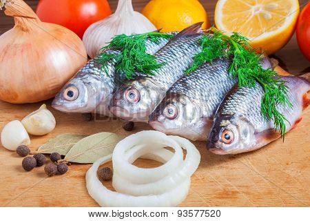 Fresh Fish And Vegetables On A Cutting Board