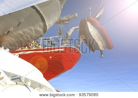 Water Reflection Of Sailing Ship And Inflatable Boat.