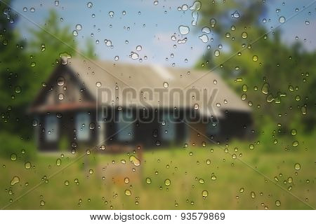 Typical Village House With Raindrops