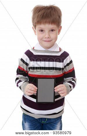 Little boy in striped shirt holds up a rectangular gray card