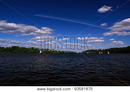 Water Reservoir on a Summer Day with Sailboats taking part in a Regatta