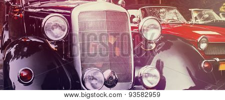 Front Headlights And Grille Of A Restored Retro Car, Close Up Frontal (styled Vintage)