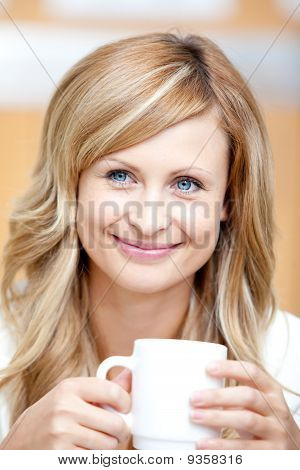 Smiling Businesswoman Holding A Cup Of Coffee