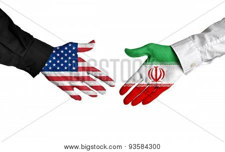 American and Iranian leaders shaking hands on a deal agreement