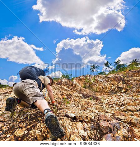 Close Up Of A Man Climbing Up Red Rock