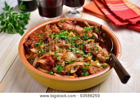 Rabbit stew a basque with onion, pepper, and parsley