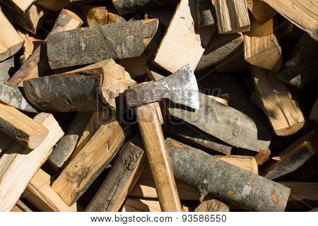 Axe On Top Of Pile Of Chopped Fire Wood