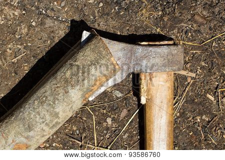 Blade Of Axe Cuts Through Timber