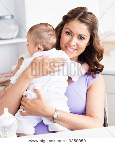Caucasian Young Mother Taking Care Of Her Adorable Baby