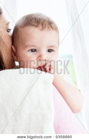 Kind Caucasian Mother Taking Care Of Her Adorable Baby
