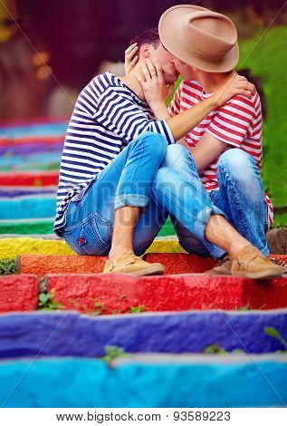 Male Couple Kissing On Rainbow Stairs, Outdoors