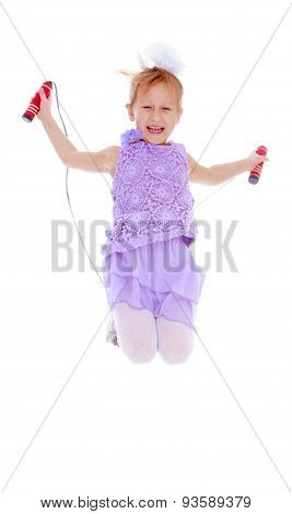 The cheerful little girl jumping skipping rope-isolated on white