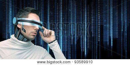 people, technology, future and programming - man with futuristic glasses and microchip implant or sensors over black background with blue binary system code