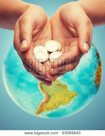 money, people, economy, charity environmental protection and finances concept - close up of woman cupped hands holding euro coins and blue background