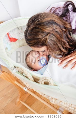 Kind Young Mother Taking Care Of Her Adorable Baby