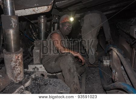 Donetsk, Ukraine - August, 16, 2013: Miners At Work In Cramped Conditions Underground Excavation. Mi
