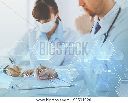 people, medicine, chemistry and pharmaceutics concept - doctor and nurse writing prescription paper over chemical formula