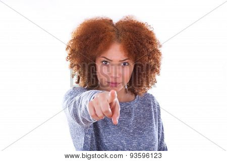 Young Angry African American Teenage Girl Pointing Finger To The Screen, Isolated On White Backgroun