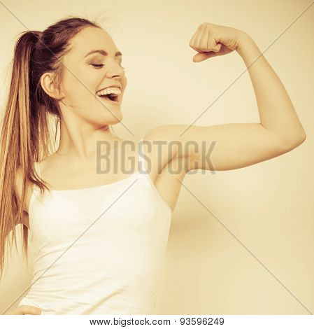 Strong Woman Showing Off Muscles. Strength.