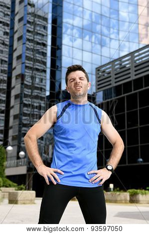 Young Sport Man Breathing Exhausted After Running Training On City Urban Background Standing Tired