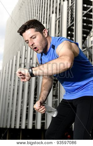 Sport Man Breathing Exhausted After Running Leaning Tired And Checking Timer Watch