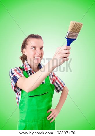 Woman painter with paintbrush