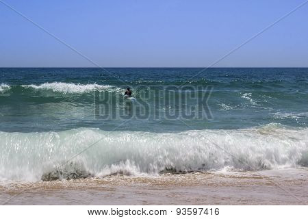 Ocean View And People Surfing In Tavira Island Coast Beach, Algarve.
