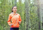 stock photo of early morning  - healthy lifestyle fitness sporty woman running early in the morning in forest area healthy lifestyle concept - JPG