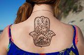 image of mehendi  - henna tattoo mehendy painted on back hamsa - JPG