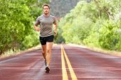 Sport and fitness runner man running on road training for marathon run doing high intensity interval poster