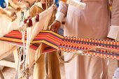 pic of nomads  - A man produces the fabric on a traditional loom in the Bedouin village Egypt - JPG