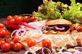 stock photo of beef-burger  - Delicious homemade burger with fresh vegetables and beef - JPG