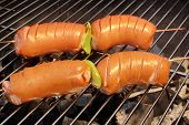 pic of grilled sausage  - Four Tasty Sausages On The Hot Barbecue Charcoal Grill Close - JPG