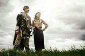 image of armor suit  - woman and man in ethnic suit context of historical reconstruction