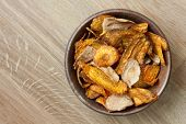 stock photo of parsnips  - Fried carrot and parsnip chips in rustic wood bowl - JPG