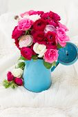 stock photo of bunch roses  - bunch of pink  ranunculus and rose flowers  in blue pot on white - JPG