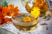 foto of marigold  - Herbal tea with marigold flowers on the table - JPG