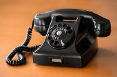 foto of rotary dial telephone  - Old fashioned retro rotary dial phone on wooden table - JPG