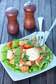 foto of caesar salad  - caesar salad on white plate and on a table - JPG
