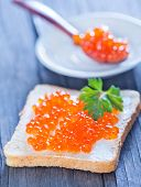 pic of banquette  - bread with caviar on the wooden table - JPG