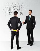 picture of backstabbers  - Ruthless businessman handshake with hiding a weapon and weapon symbols around his head - JPG
