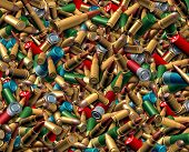 stock photo of bullet  - Ammunition bullets background as a dangerous explosives concept with a group of different calibre ammo representing the risk of violence and security social issues involving firearm weapons - JPG