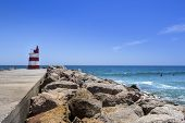 image of inlet  - Ocean view and small lighthouse in the inlet jetty of Tavira Island Algarve Portugal - JPG